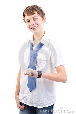 Young boy checking his watch