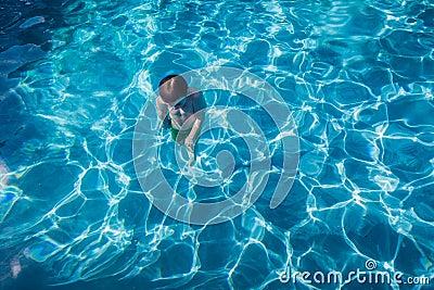 Boy Underwater Surfacing Pool