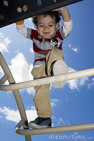 Young Boy Climbing on Jungle Gym