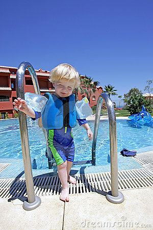 Free Young Boy Climbing Out Of Swimming Pool On Vacation Royalty Free Stock Photos - 219778