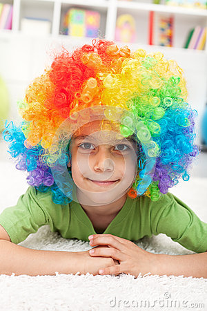 Young boy with clown wig
