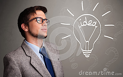 Young boy comming up with a light bulb idea sign
