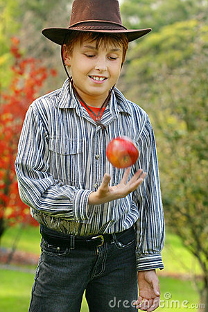 Young Boy in Country with Red Apple