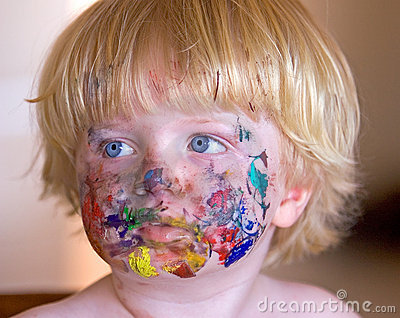 Young boy covered in face paint