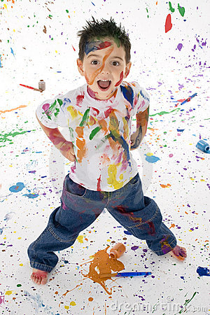 Free Young Boy Covered In Paint Splatter Stock Image - 1358511
