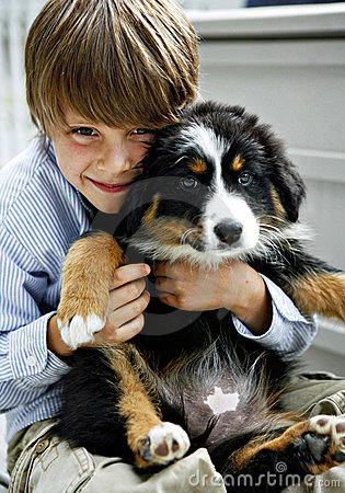 Young Boy with Cute Puppy