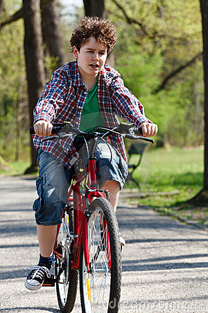 Free Young Boy Cycling Stock Photo - 19582420