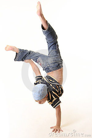 Young boy doing a one handed handstand