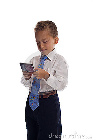 Free Young Boy Dressed As Businessman Sends SMS Royalty Free Stock Photos - 5584498