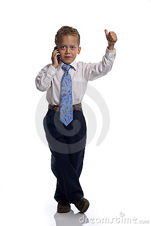 Free Young Boy Dressed As Businessman Talks On Celphone Stock Images - 5469524