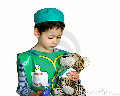 A young boy dressing up as a doctor