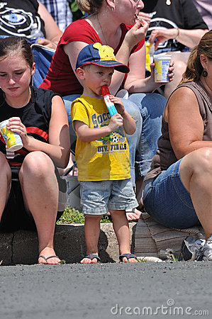 Young Boy Eating a Frozen Treat Editorial Photography