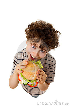 Young boy eating healthy sandwich