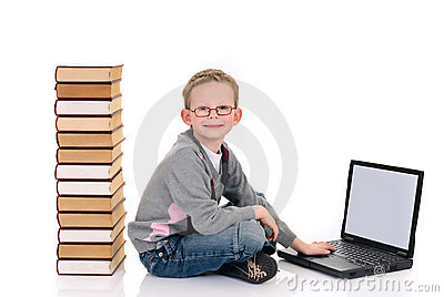 Young boy with encyclopedia
