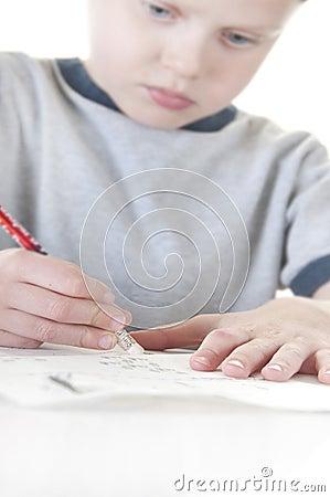 Young boy erasing mistake