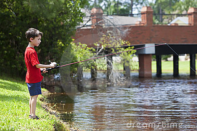 Young Boy Fishing On A RIver