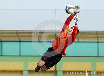 Young boy football or soccer goalkeeper jump parade Editorial Photography