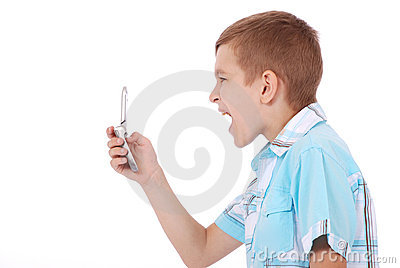 A young boy is furiously screaming