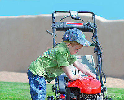 Young boy and garden mower