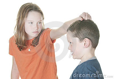 Young boy and girl fighting