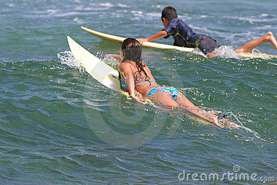 Young boy and girl go surfing in Hawaii