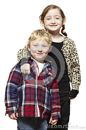 Young boy and girl smiling casually dressed