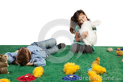 Young boy and girl with toy bunnies and chicks