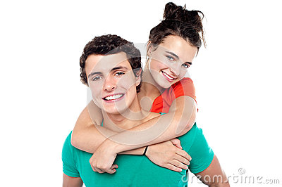 Young boy giving his girlfriend piggyback ride