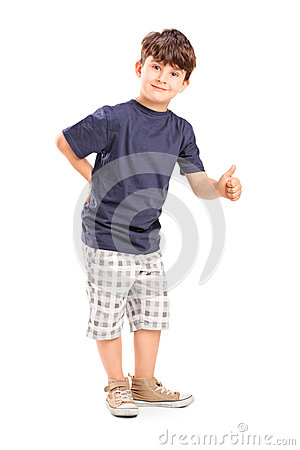 Young boy giving a thumb up
