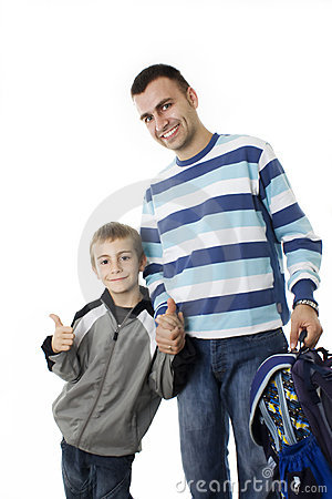 Young boy going to school with his father