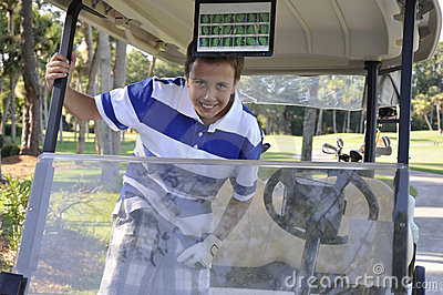 Young boy in golf cart