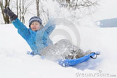 Young boy having fun on snow