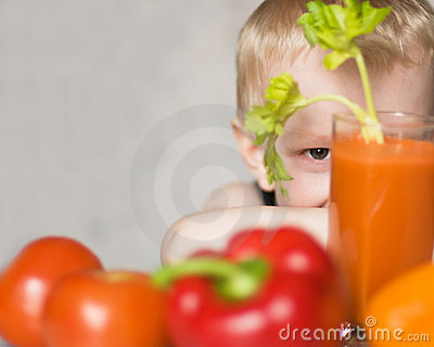 Young boy hiding among vegetables
