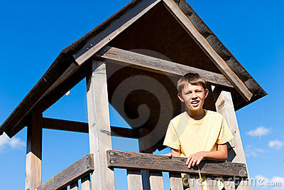 Young boy in a high seat
