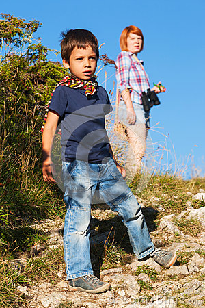 Boy hiking with his mother