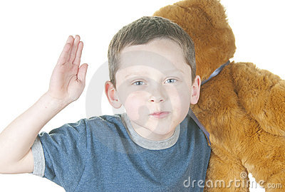 Young boy holding bear