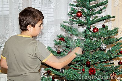 Young boy holding Christmas decorations