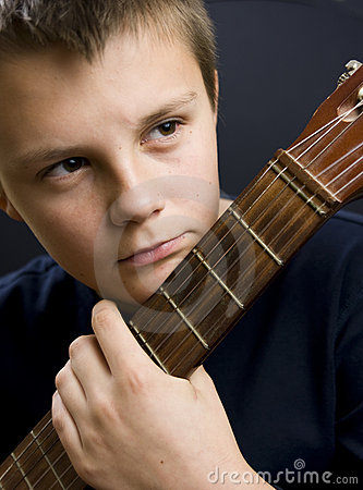 Free Young Boy Holding Guitar Royalty Free Stock Images - 11707779