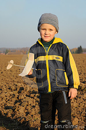 Young boy holding plane model