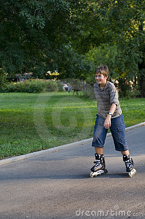 Young boy inline skating