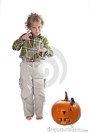 Young boy with jack-o-lantern