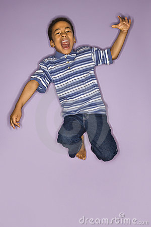 Young boy jumping.