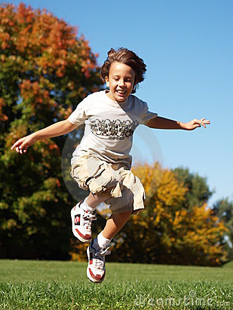 Young boy jumping in air