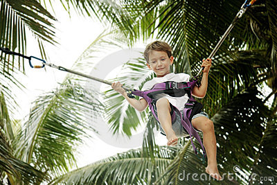 Young boy jumping bungee