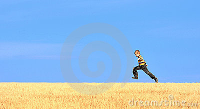 Young boy jumping on field