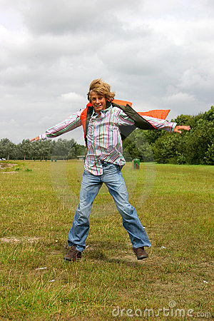 Young boy jumping for joy II
