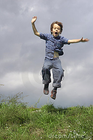 Young Boy Jumping And Shouting