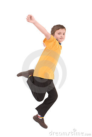 Young boy jumping up