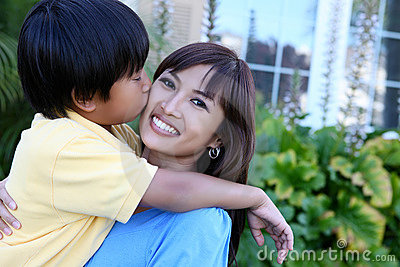Young Boy Kissing Mother