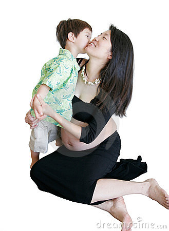 Young Boy kissing pregnant mom